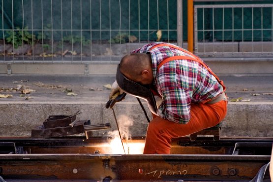 Construction Worker Fixing Rails (Horizontal View)
